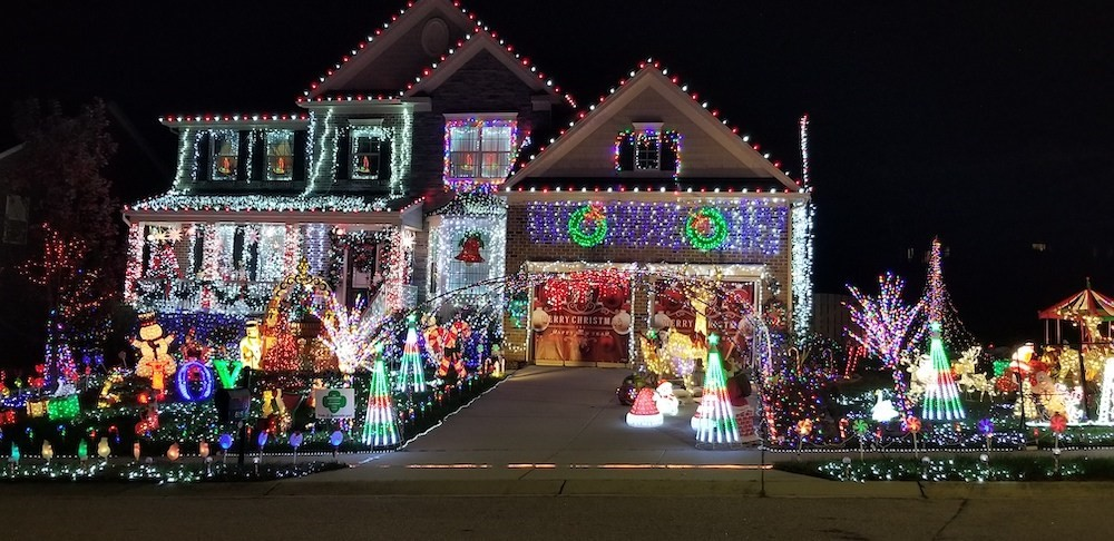 An overly decorated with Christmad lights and figures suburban home.