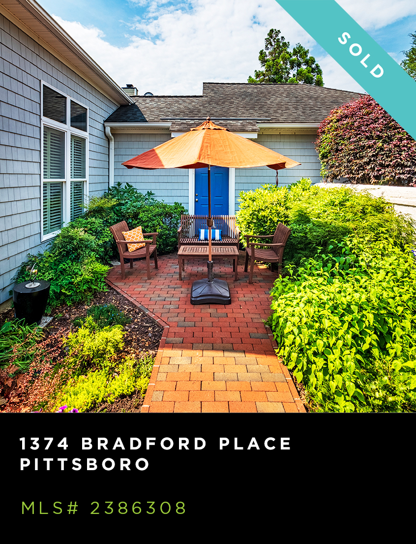 1374 Bradford Place home for sale, rear patio with landscaping, umbrella & seating