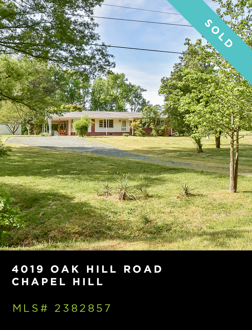 4019 Oak Hill Road home for sale, front facade, brick ranch with expansive front yard