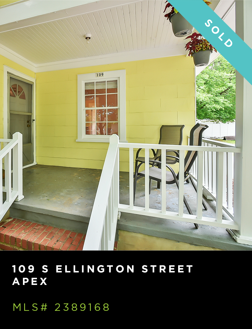 109 S Ellington Street for sale, front porch of yellow home with chairs and hanging plants