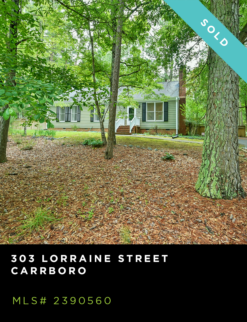 303 Lorraine Street home for sale, grey/green ranch home with wooded front yard