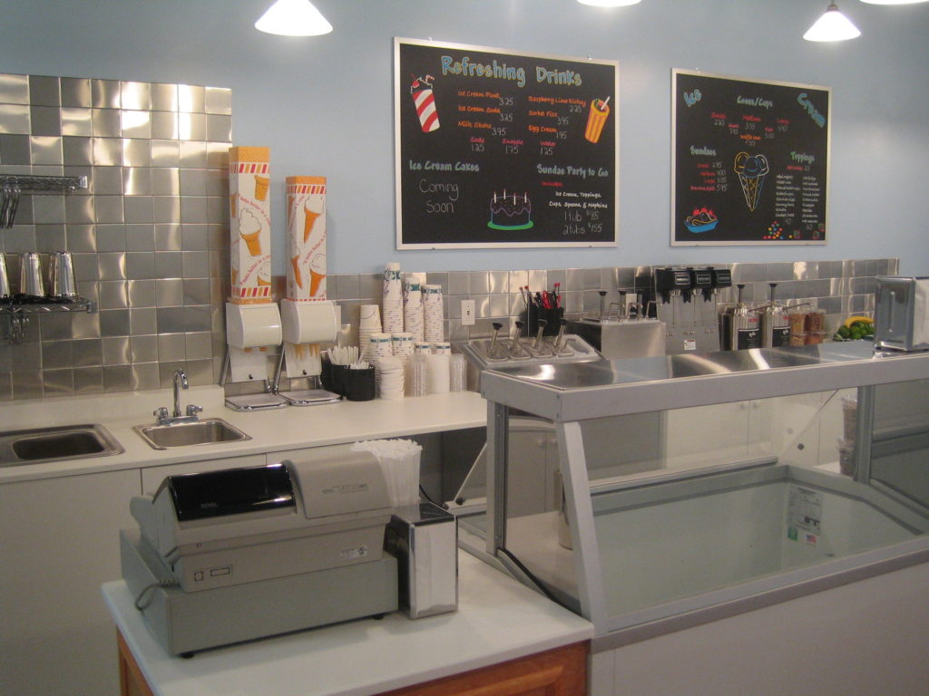 Interior photo of menus, freezers, counter items at Here's the Scoop, formerly in Bronxville.