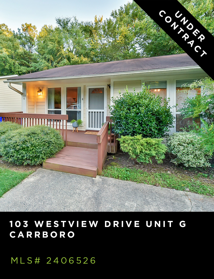 103 Westview, Unit G, Carrboro, condo for sale, front facade of one level beige home with porch, shrubs and driveway